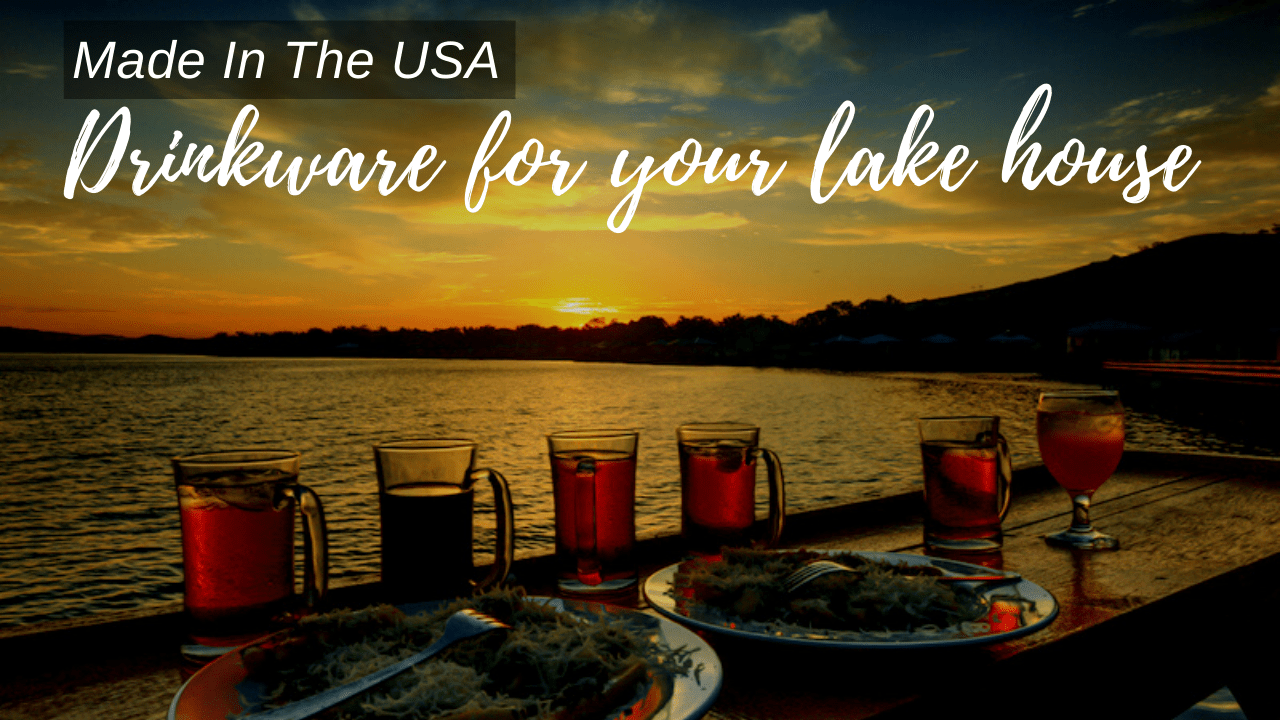 Dinner set on a beautiful porch by a lake on a sunset